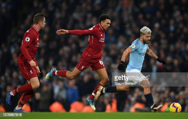 Sergio Aguero of Manchester City is challenged by Trent AlexanderArnold of Liverpool during the Premier League match between Manchester City and...