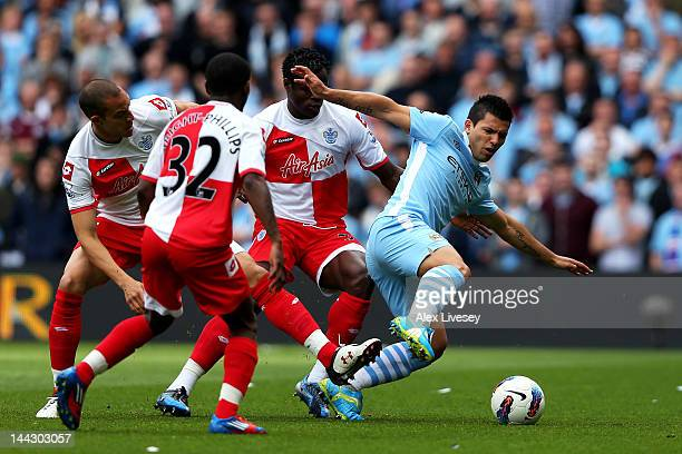 Sergio Aguero of Manchester City is closed down by the QPR defence during the Barclays Premier League match between Manchester City and Queens Park...