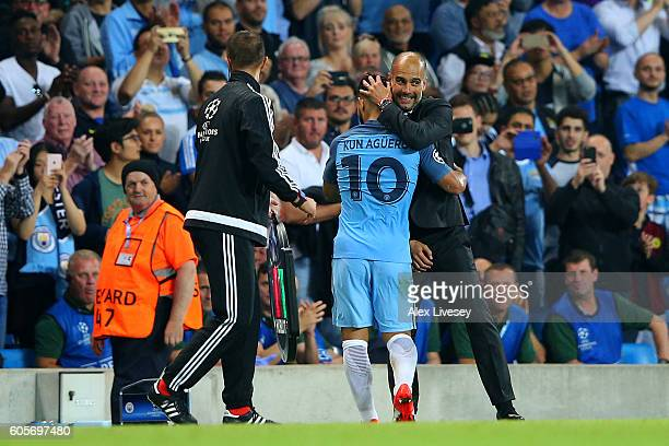 Sergio Aguero of Manchester City is congratulated by Josep Guardiola manager of Manchester City during the UEFA Champions League match between...
