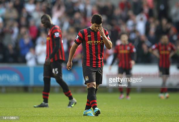 Sergio Aguero of Manchester City is dejected after Luke Moore of Swansea City scores during the Barclays Premier League match between Swansea City...