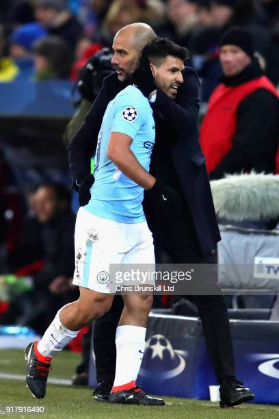 Sergio Aguero of Manchester City is greeted by Pep Guardiola Manager of Manchester City as he is substituted during the UEFA Champions League Round...
