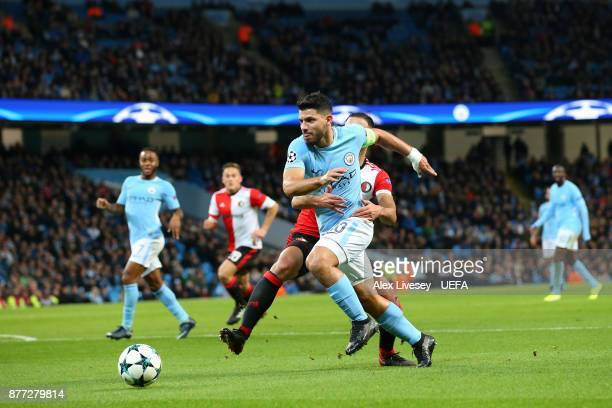 Sergio Aguero of Manchester City is held back by Sofyan Amrabat of Feyenoord during the UEFA Champions League group F match between Manchester City...