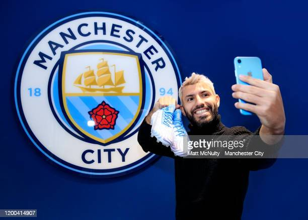 Sergio Aguero of Manchester City is presented with an exclusive pair of Puma football boots in recognition after breaking the record for the number...