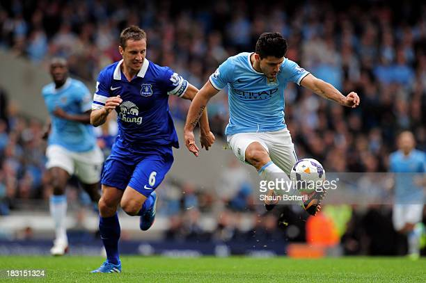 Sergio Aguero of Manchester City is pursued by Phil Jagielka of Everton during the Barclays Premier League match between Manchester City and Everton...