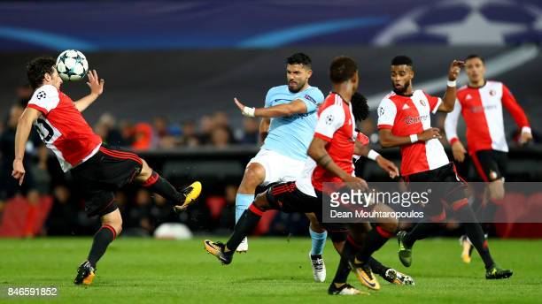 Sergio Aguero of Manchester City is qathced by the Feyenoord defence during the UEFA Champions League group F match between Feyenoord and Manchester...