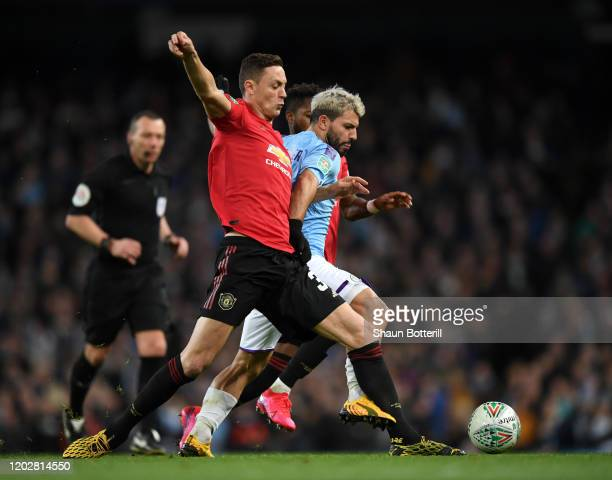 Sergio Aguero of Manchester City is tackled by Nemanja Matic and Fred of Manchester United during the Carabao Cup Semi Final match between Manchester...