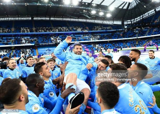 Sergio Aguero of Manchester City is thrown into the air by teammates during the Premier League match between Manchester City and Everton at Etihad...