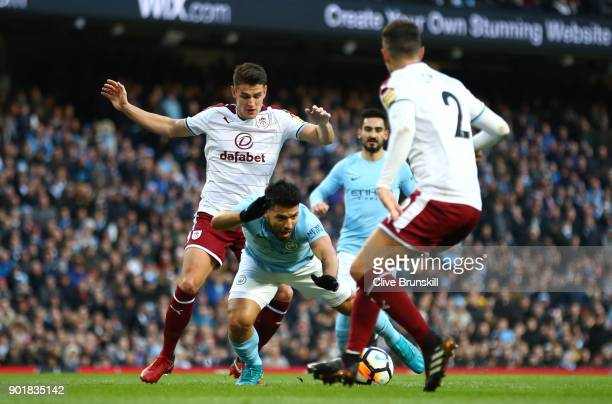 Sergio Aguero of Manchester City is tripped by Ashley Westwood of Burnley during the The Emirates FA Cup Third Round match between Manchester City...