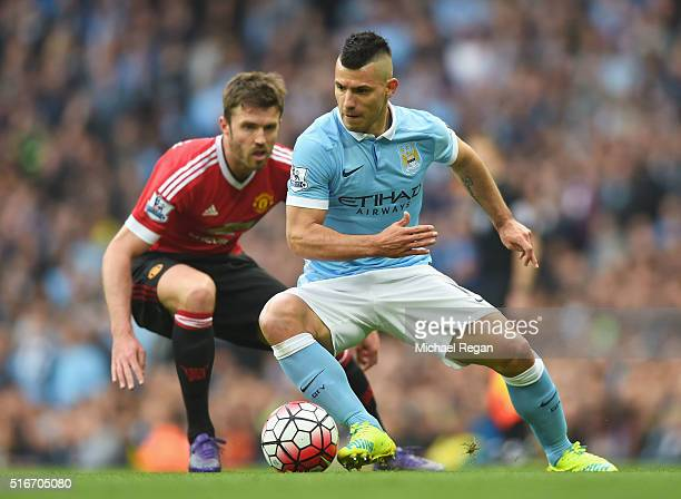 Sergio Aguero of Manchester City is watched by Michael Carrick of Manchester United during the Barclays Premier League match between Manchester City...