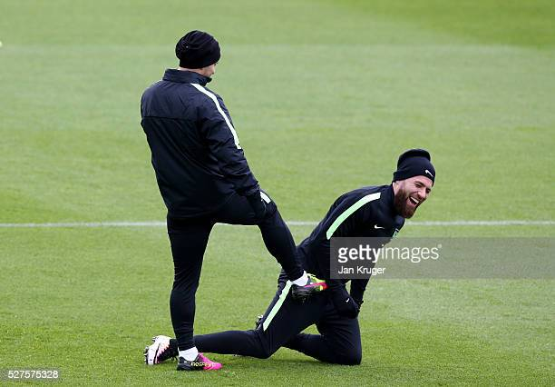 Sergio Aguero of Manchester City jokes with Nicolas Otamendi of Manchester City during a training session ahead of the UEFA Champions League Semi...