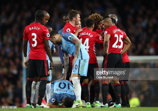 Sergio Aguero of Manchester City lays on the ground following a clash with Marouane Fellaini of Manchester United during the Premier League match...