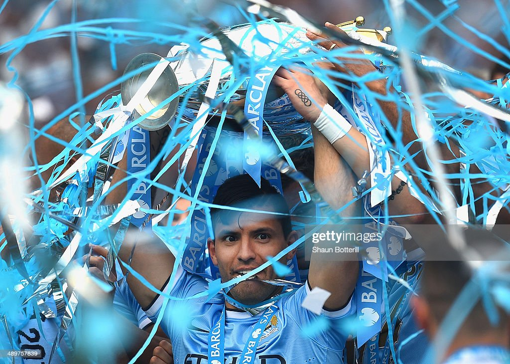 Sergio Aguero of Manchester City lifts the Premier League trophy at the end of the Barclays Premier League match between Manchester City and West Ham United at Etihad Stadium on May 11, 2014 in Manchester, England.