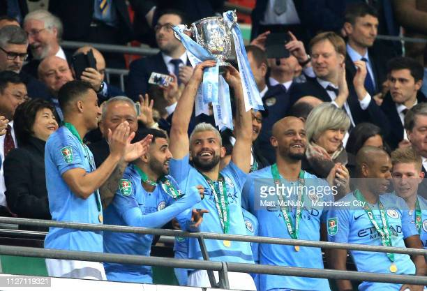 Sergio Aguero of Manchester City lifts the trophy after winning the Carabao Cup Final between Chelsea and Manchester City at Wembley Stadium on...