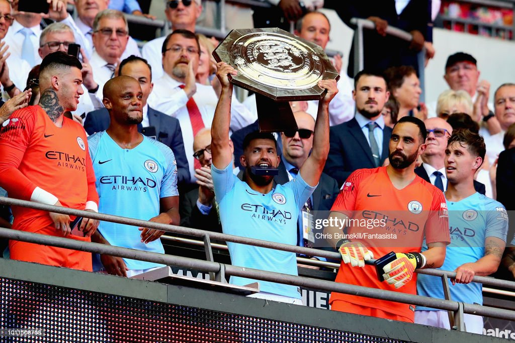 Sergio Aguero of Manchester City lifts the trophy to celebrate winning the FA Community Shield match between Manchester City and Chelsea at Wembley Stadium on August 5, 2018 in London, England.