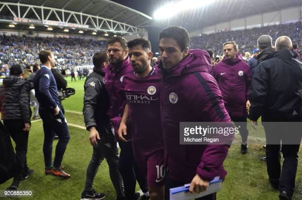 Sergio Aguero of Manchester City looks dejected as he leaves the pitch with assistant coach Mikel Arteta after the Emirates FA Cup Fifth Round match...