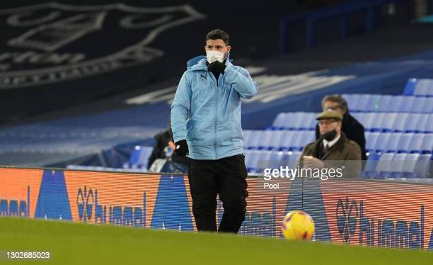 Sergio Aguero of Manchester City looks on whilst wearing a face mask during the Premier League match between Everton and Manchester City at Goodison...