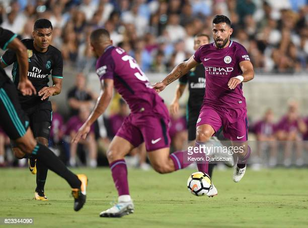 Sergio Aguero of Manchester City looks to pass the ball to Gabriel Jesus on attack against Real Madrid during the first half of their International...