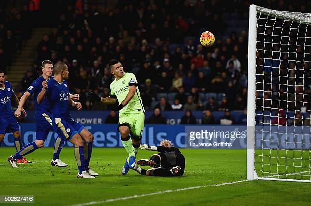 Sergio Aguero of Manchester City misses as goalkeeper Kasper Schmeichel of Leicester City attempts to block during the Barclays Premier League match...