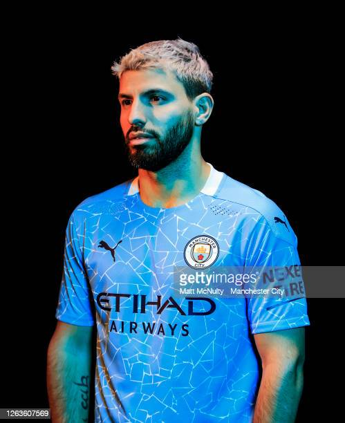 Sergio Aguero of Manchester City poses wearing the 2020/21 Puma home jersey at the City Football Academy on August 03, 2020 in Manchester, England.