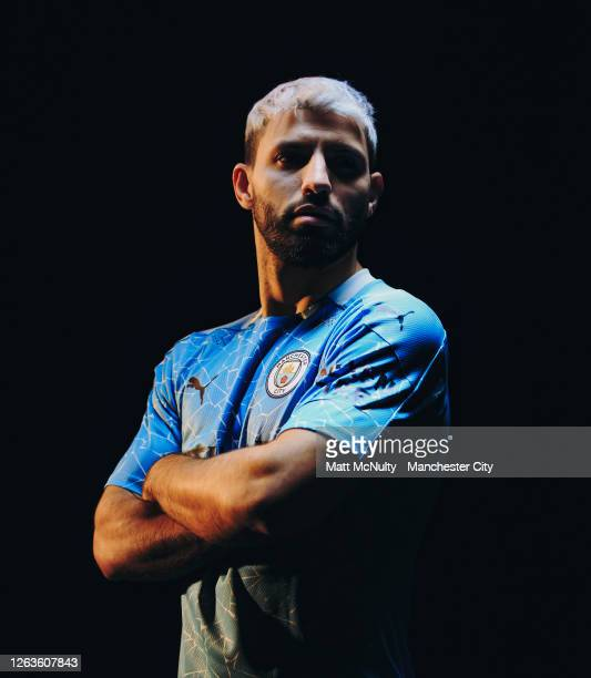 Sergio Aguero of Manchester City poses wearing the 2020/21 Puma home jersey at the City Football Academy on August 03 2020 in Manchester England