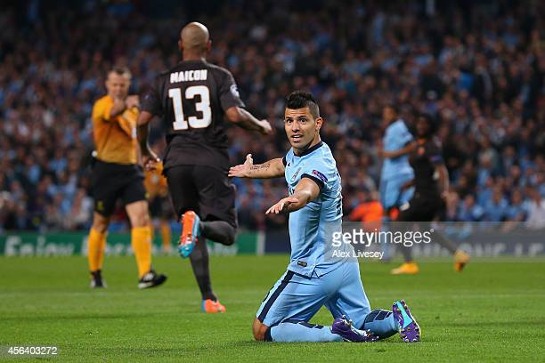 Sergio Aguero of Manchester City protests after being fouled in the penalty box during the UEFA Champions League Group E match between Manchester...