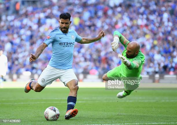 Sergio Aguero of Manchester City puts his shot wide under pressure from Willy Caballero of Chelsea during the FA Community Shield between Manchester...
