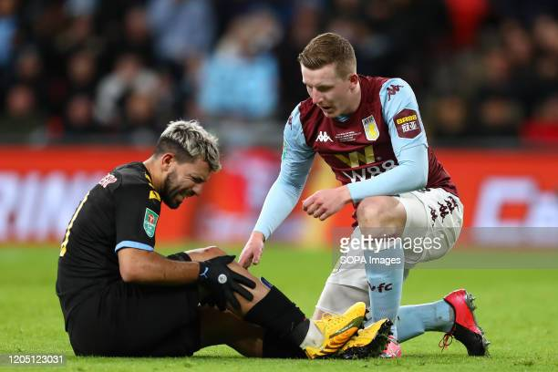 Sergio Aguero of Manchester City reacts after being fouled by Matt Targett of Aston Villa during the Carabao Cup Final match between Aston Villa and...