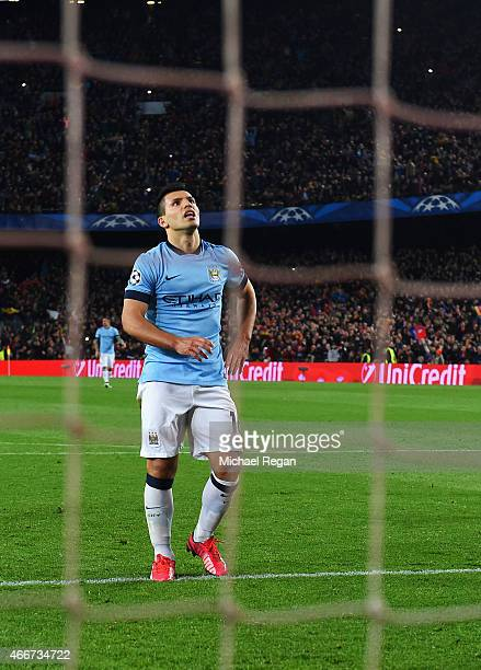 Sergio Aguero of Manchester City reacts after seeing his penalty saved by MarcAndre ter Stegen of Barcelona during the UEFA Champions League Round of...