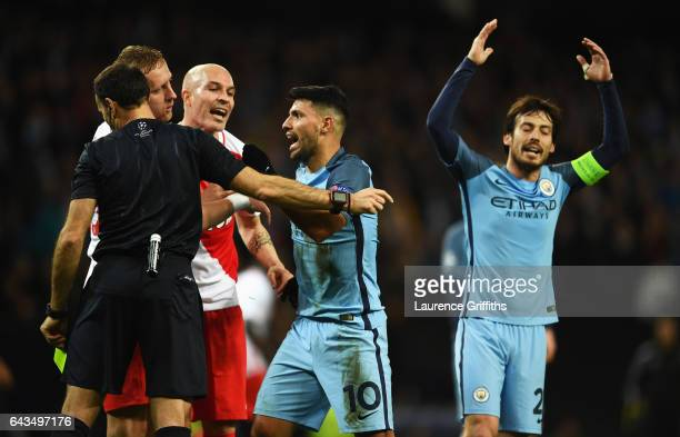 Sergio Aguero of Manchester City reacts as he is shown a yellow card by referee Antonio Miguel Mateu Lahoz during the UEFA Champions League Round of...