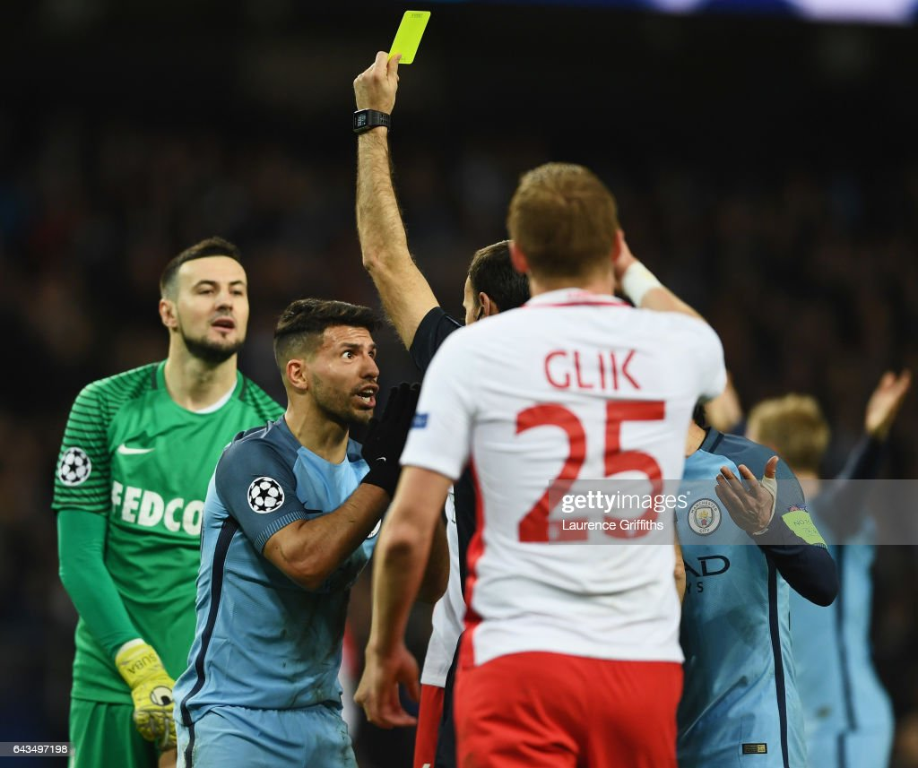 Sergio Aguero of Manchester City (2L) reacts as he is shown a yellow card by referee Antonio Miguel Mateu Lahoz during the UEFA Champions League Round of 16 first leg match between Manchester City FC and AS Monaco at Etihad Stadium on February 21, 2017 in Manchester, United Kingdom.