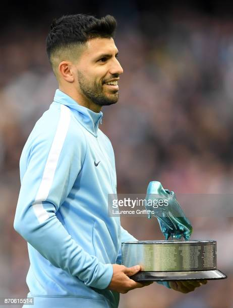 Sergio Aguero of Manchester City recieves an award for becoming the clubs highest goal scorer prior to the Premier League match between Manchester...