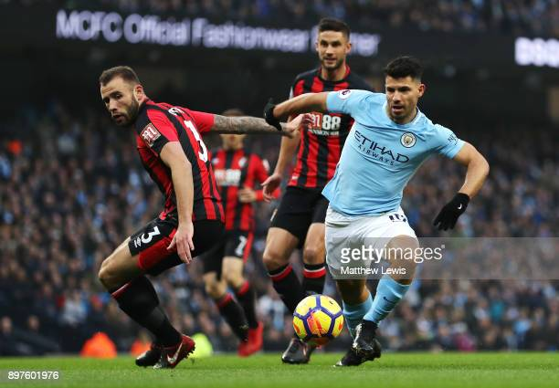 Sergio Aguero of Manchester City runs with the ball away from Steve Cook of AFC Bournemouth during the Premier League match between Manchester City...