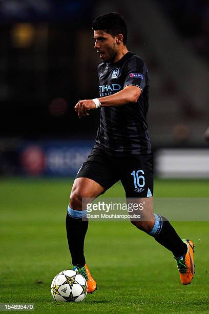 Sergio Aguero of Manchester City runs with the ball during the Group D UEFA Champions League match between AFC Ajax and Manchester City FC at...