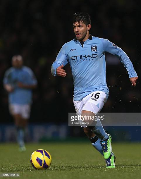 Sergio Aguero of Manchester City runs with the ball during the Barclays Premier League match between Norwich City and Manchester City at Carrow Road...