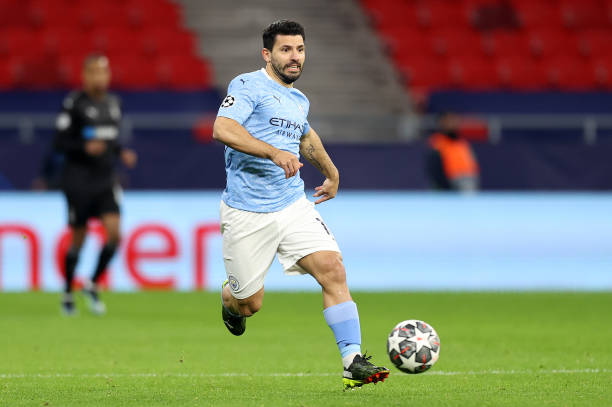 Sergio Aguero of Manchester City runs with the ball during the UEFA Champions League Round of 16 match between Manchester City and Borussia...
