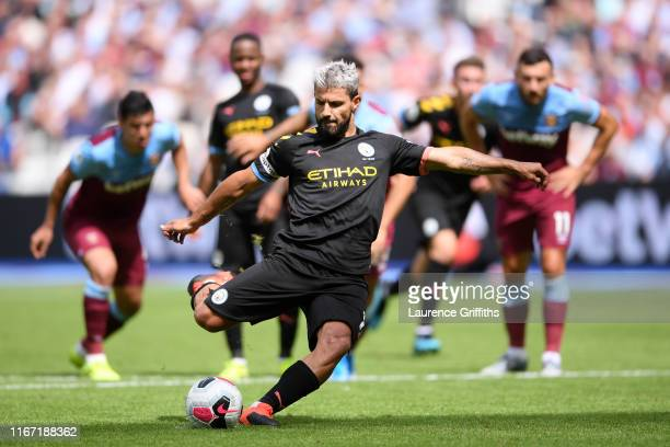 Sergio Aguero of Manchester City scores a penalty for his team's fourth goal during the Premier League match between West Ham United and Manchester...