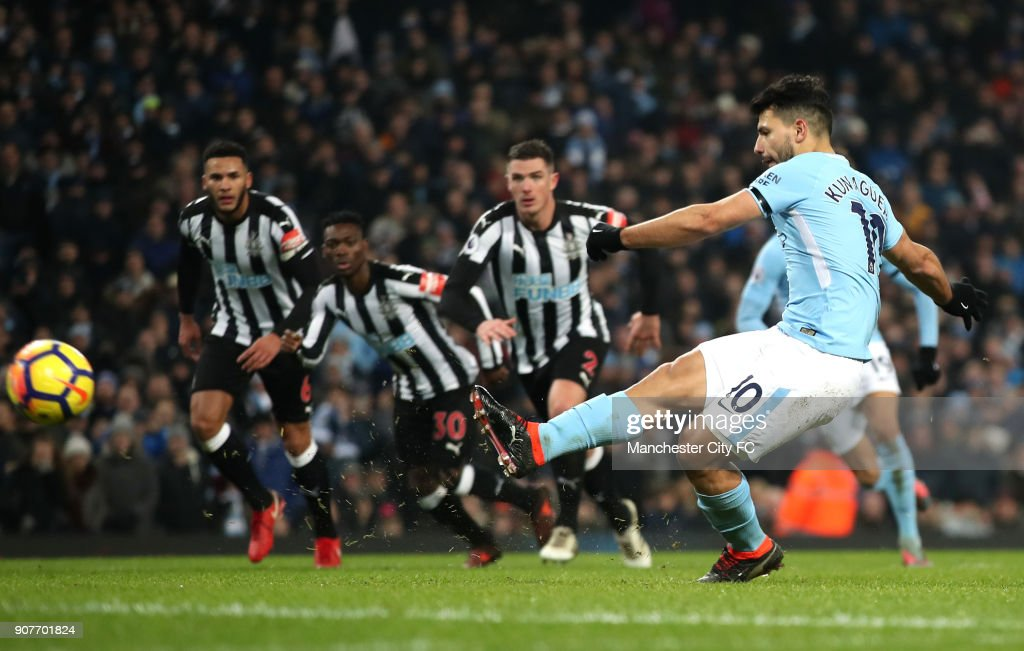 Sergio Aguero of Manchester City scores a penalty, his side's second goal during the Premier League match between Manchester City and Newcastle United at Etihad Stadium on January 20, 2018 in Manchester, England.