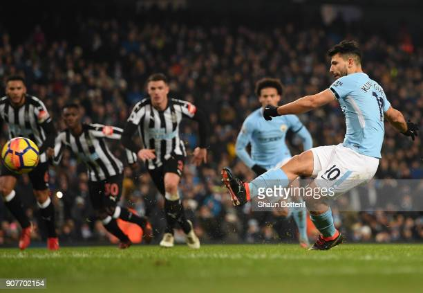 Sergio Aguero of Manchester City scores a penalty his side's second goal during the Premier League match between Manchester City and Newcastle United...