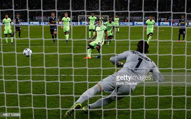 Sergio Aguero of Manchester City scores a penalty to his team's second goal against goalkeeper Yann Sommer of Borussia Monchengladbach during the...
