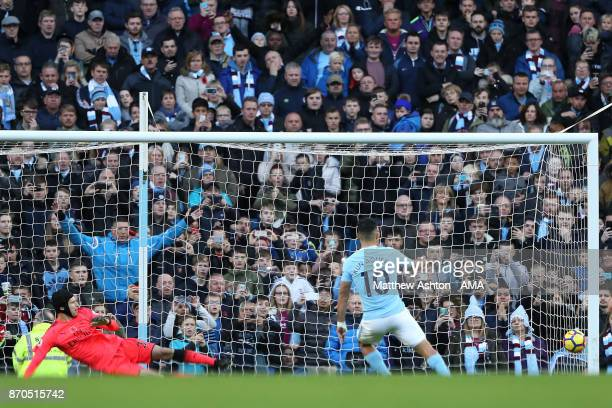 Sergio Aguero of Manchester City scores a penalty to make the score 20 during the Premier League match between Manchester City and Arsenal at Etihad...