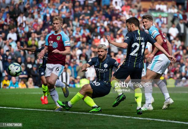 Sergio Aguero of Manchester City scores during the Premier League match between Burnley FC and Manchester City at Turf Moor on April 28 2019 in...