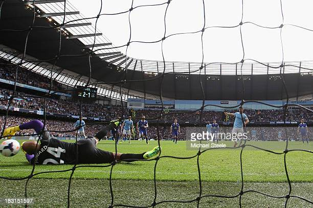 Sergio Aguero of Manchester City scores from a penalty as the ball rebounds off the post and hits goalkeeperTim Howard of Everton during the Barclays...