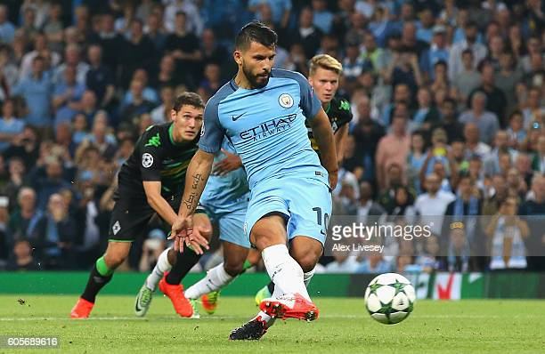 Sergio Aguero of Manchester City scores from the spot during the UEFA Champions League match between Manchester City FC and VfL Borussia...