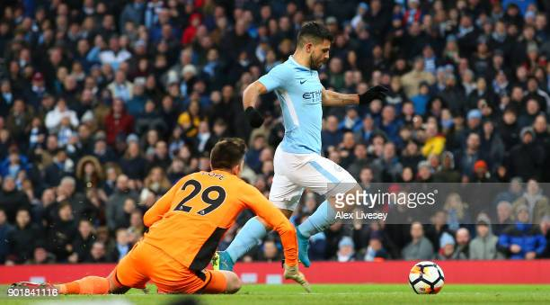 Sergio Aguero of Manchester City scores his second goal during The Emirates FA Cup Third Round match between Manchester City and Burnley at Etihad...