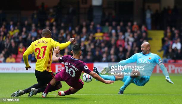 Sergio Aguero of Manchester City scores his sides fifth goal past Heurelho Gomes of Watford while under pressure from Christian Kabasele of Watford...