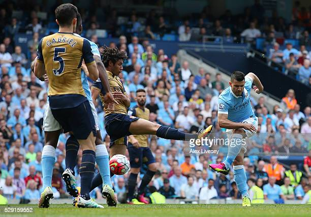 Sergio Aguero of Manchester City scores his side's first goal during the Barclays Premier League match between Manchester City and Arsenal at the...