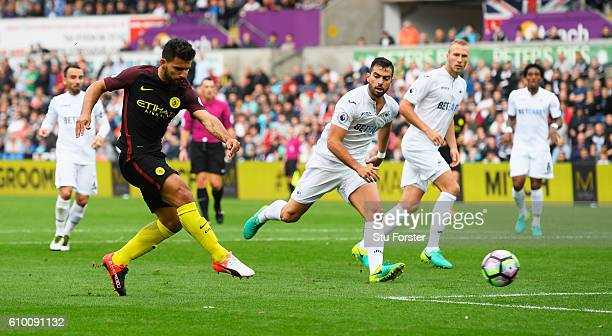 Sergio Aguero of Manchester City scores his sides first goal during the Premier League match between Swansea City and Manchester City at the Liberty...