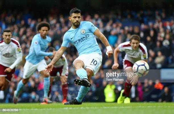 Sergio Aguero of Manchester City scores his side's first goal during the Premier League match between Manchester City and Burnley at Etihad Stadium...