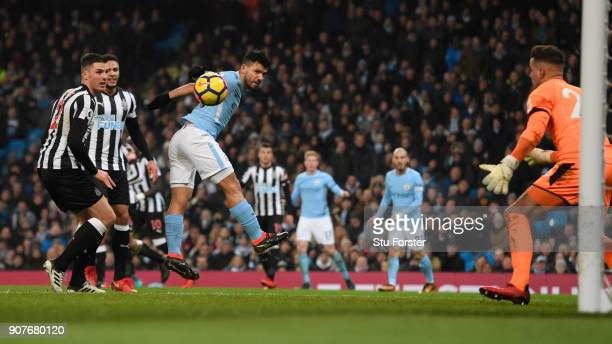 Sergio Aguero of Manchester City scores his side's first goal during the Premier League match between Manchester City and Newcastle United at Etihad...