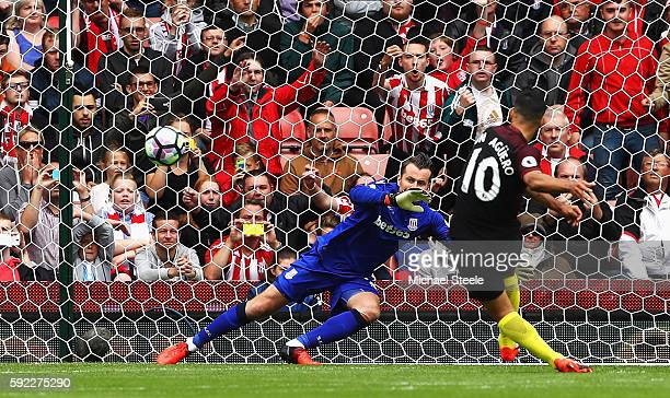 Sergio Aguero of Manchester City scores his sides first goal past Shay Given of Stoke City during the Premier League match between Stoke City and...